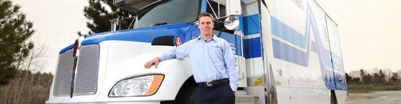 Gentleman in front of Wm. Duggan Co. moving truck